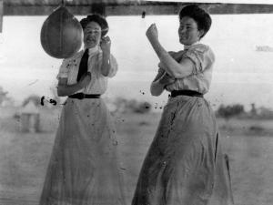 StateLibQld_1_45199_Two_women_sparring_with_a_speed_bag